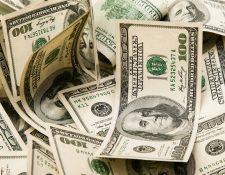 Hasta el pasado 15 de septiembre el ingreso de divisas por remesas familiares era del 13% y para este año se proyecta un crecimiento de US$10 mil 300 millones. (Foto Prensa Libre: Hemeroteca)