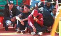 """GRAFAND650. ALGECIRAS (CÁDIZ), 18/09/2019.- Varios de los 73 inmigrantes, todos ellos varones de origen magrebí, que han sido rescatados por el buque de Salvamento Marítimo """"Guardamar Concepción Arenal"""", a su llegada al puerto de Algeciras donde serán atendidos por Cruz Roja y trasladados por la Guardia Civil. EFE/ A.Carrasco Ragel"""