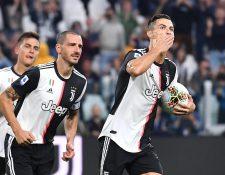 Cristiano Ronaldo celebra después de anotar el tanto de la victoria contra el  Hellas Verona FC. ( Foto Prensa Libre: EFE).