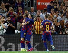 Griezmann y Messi por primera vez juntos de titulares con el Barcelona. (Foto Prensa Libre: EFE)
