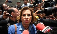 (FILES) In this file photo taken on August 11, 2019 Guatemalan candidate for the National Union of Hope (Union Nacional de la Esperanza) party, Sandra Torres, speaks to the press after voting at a polling station in Guatemala City. - Guatemalan former presidential candidate and former Guatemalan First Lady (2008-2011) Sandra Torres, was arrested on September 2, 2019 over corruption charges for alleged links with a 2015 corruption case in her party, the public prosecutor's office informed. (Photo by Johan ORDONEZ / AFP)