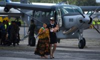 Relatives of one of the tree soldiers killed in El Estor municipality, Izabal department, are accompanied by officials upon the arrival of their coffins at the Air Force Base in Guatemala City on September 05, 2019. - A group of alleged drug traffickers executed three soldiers in northern Guatemala after an ambush on Tuesday in which three other military men were wounded and two went missing, government sources reported. (Photo by Johan ORDONEZ / AFP)