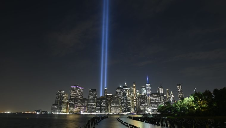 The Tribute in Light shines into the sky over Manhattan's skyline on September 11, 2019 in New York. - The art installation of 88 searchlights is marking the 18th anniversary of the 911 attacks (Photo by Johannes EISELE / AFP)