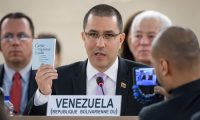 Venezuela's Minister of Foreign Affairs Jorge Arreaza shows the charter of the United Nations during his address to the United Nations Human Rights Council on September 12, 2019, in Geneva. (Photo by FABRICE COFFRINI / AFP)