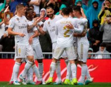 Real Madrid's French forward Karim Benzema (C) celebrates with teammates after scoring  during the Spanish league football match Real Madrid CF against Levante UD at the Santiago Bernabeu stadium in Madrid on September 14, 2019. (Photo by CURTO DE LA TORRE / AFP)