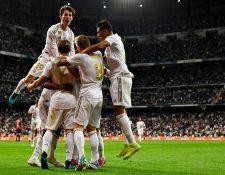 Los jugadores del Real Madrid festejan el gol de Rodrygo. (Foto Prensa Libre: AFP)