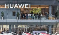 This photo taken on September 28, 2019 shows people visiting a newly-opened Huawei flagship store in Shenzhen in China's southern Guangdong province. (Photo by STR / AFP) / China OUT