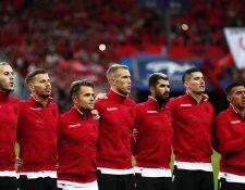 Los seleccionados de Albania se vieron sorprendidos cuando en lugar de su himno sonó el de Andorra. (Foto Prensa Libre: EFE).