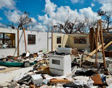 TOPSHOT - A destroyed home is seen at Freeport on Grand Bahama island on September 10, 2019. - Some 2,500 people are unaccounted for in the Bahamas following Hurricane Dorian, the Bahamian National Emergency Management Agency (NEMA) said September 11, 2019. At least 50 people died in the hurricane, which slammed into the northern Bahamas as a Category 5 storm, and officials have said they expect the number to rise significantly. (Photo by Leila MACOR / AFP)