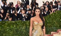 "Kim Kardashian arrives for the 2018 Met Gala on May 7, 2018 at the Metropolitan Museum of Art in New York. The Gala raises money for the Metropolitan Museum of Art's Costume Institute. The Gala's 2018 theme is ""Heavenly Bodies: Fashion and the Catholic Imagination."" / AFP PHOTO / Hector RETAMAL"