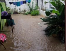 Fuerte lluvia causó inundaciones en San José la Máquina, Suchitepéquez. (Foto Prensa Libre: Conred).