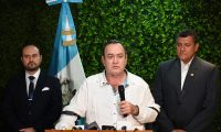 Guatemala's president-elect Alejandro Giammattei (C), flanked by Vice President-elect Guillermo Castillo (R) and designated Minister of Foreign Affair Pedro Brolo speaks during a press conference at La Aurora airport in Guatemala City, on October 12, 2019. - Giammattei denounced the fact that he was denied entry into Venezuela, where he traveled to meet with opposition leader Juann Guaido, who has been recognized as interim president of Venezuela by about 50 countries. (Photo by Johan ORDONEZ / AFP)