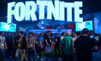 (FILES) In this file photo taken on June 12, 2018, people crowd the display area for the survival game Fortnite at the 24th Electronic Expo, or E3 2018, in Los Angeles, California. - Internet gaming phenomenon Fortnite has temporarily gone offline, leaving millions of addicted gamers wondering what to do with themselves, after a massive asteroid brought the latest season to an end. Epic Games, Fortnite's creators, announced that season ten of the shoot-'em-up survival video game would end on October 13, 2019 and many users expected season eleven to follow immediately. (Photo by Frederic J. BROWN / AFP)