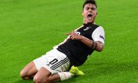 Juventus' Argentine forward Paulo Dybala celebrates after scoring his second goal during the UEFA Champions League Group D football match Juventus vs Lokomotiv Moscow on October 22, 2019 at the Juventus stadium in Turin. (Photo by Miguel MEDINA / AFP)