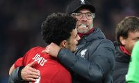 Liverpool's English midfielder Curtis Jones (L) is congratulated by Liverpool's German manager Jurgen Klopp after scoring the winning penalty in a penalty shoot-out during the English League Cup fourth round football match between Liverpool and Arsenal at Anfield in Liverpool, north west England on October 30, 2019. - Liverpool won the match after winning the penalty shoot out, following a 5-5 draw in the match. (Photo by Paul ELLIS / AFP) / RESTRICTED TO EDITORIAL USE. No use with unauthorized audio, video, data, fixture lists, club/league logos or 'live' services. Online in-match use limited to 75 images, no video emulation. No use in betting, games or single club/league/player publications. /