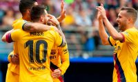 Barcelona's players celebrate after Barcelona's Argentine forward Lionel Messi scored during the Spanish league football match SD Eibar against FC Barcelona at the Ipurua stadium in Eibar on October 19, 2019. (Photo by STRINGER / AFP)