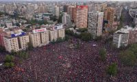 In this aerial view thousands of people protest in Santiago, on October 25, 2019, a week after violent protests started. - Demonstrations against a hike in metro ticket prices in Chile's capital exploded into violence on October 18, unleashing widening protests over living costs and social inequality. (Photo by Pedro Ugarte / AFP)