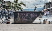 Honduran riot police stand guard during a demonstration demanding President Juan Orlando Hernandez resignation for his alleged links to drug trafficking in Tegucigalpa, on October 21, 2019. - Opposition parties in Honduras accused Hernandez of running a drug and corruption network and called for street protests to demand the president resignation, after a New York court convicted the Honduran president's brother of drug trafficking Friday. (Photo by ORLANDO SIERRA / AFP)