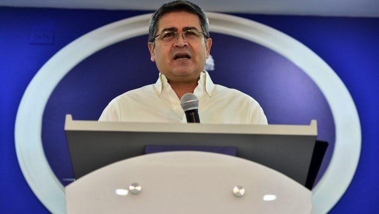 El presidente hondureño, Juan Orlando Hernández, recibió US$1 millón para su campaña, dice testigo. (Foto Prensa Libre: AFP)