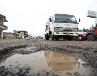 Parte de la ruta Interamericana que va de Cuatro Caminos a Huehuetenango está en pésimas condiciones. (Foto Prensa Libre: Hemeroteca PL)