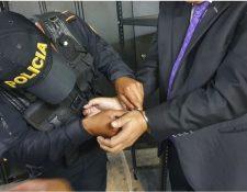 Los detenidos están investigados por lavado de dinero. (Foto Prensa Libre: PNC)