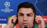 Juventus' Portuguese forward Cristiano Ronaldo adjusts his headset during a press conference on October 21, 2019 in Turin, on the eve of Juventus' UEFA Champions League stage Group D match against Lokomotiv Moscow. (Photo by Marco Bertorello / AFP)