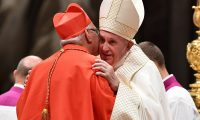 Pope Francis (R) embraces new Cardinal Guatemalan prelate Alvaro Leonel Ramazzini Imeri after he appointed him during an Ordinary Public Consistory for the creation of new cardinals, for the imposition of the biretta, the consignment of the ring and the assignment of the Title or Diaconate, on October 5, 2019 at St. Peter's Basilica in the Vatican. - Pope Francis appoints 13 new cardinals at the 2019 Ordinary Public Consistory, choosing prelates whose lifelong careers reflect their commitment to serve the marginalized and local church communities, hailing from 11 different nations and representing multiple religious orders. (Photo by Tiziana FABI / AFP)
