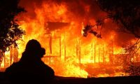 GEYSERVILLE, CALIFORNIA - OCTOBER 24: A home burns as the Kincade Fire moves through the area on October 24, 2019 in Geyserville, California. Fueled by high winds, the Kincade Fire has burned over 7,000 acres in a matter of hours and has prompted evacuations in the Geyserville area.   Justin Sullivan/Getty Images/AFP == FOR NEWSPAPERS, INTERNET, TELCOS & TELEVISION USE ONLY ==