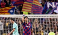 Barcelona's Uruguayan forward Luis Suarez celebrates his second goal beside Inter Milan's Uruguayan defender Diego Godin during the UEFA Champions League Group F football match between Barcelona and Inter Milan at the Camp Nou stadium in Barcelona, on October 2, 2019. (Photo by Josep LAGO / AFP)