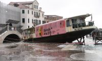 Venice (Italy), 13/11/2019.- A view of a ferry stranded on the docks following bad weather in Venice, northern Italy, 13 November 2019. A wave of bad weather has hit much of Italy on 12 November. Levels of 100-120cm above sea level are fairly common in the lagoon city and Venice is well-equipped to cope with its rafts of pontoon walkways. (Italia, Niza, Venecia) EFE/EPA/ANDREA MEROLA