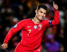 Crisitano durante el partido entre Portugal y Lituania. (Foto Prensa Libre: AFP)