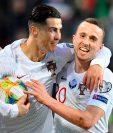 Cristiano Ronaldo (i) celebra su gol en el triunfo de Portugal contra Luxemburgo. (Foto Prensa Libre: )