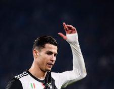 Cristiano dejó el partido contra el Milán, evidentemente molesto por no poder continuar. (Foto Prensa Libre: AFP)
