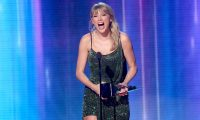 LOS ANGELES, CALIFORNIA - NOVEMBER 24: Taylor Swift accepts the Favorite Album - Pop/Rock award for 'Lover' performs onstage during the 2019 American Music Awards at Microsoft Theater on November 24, 2019 in Los Angeles, California.   JC Olivera/Getty Images/AFP == FOR NEWSPAPERS, INTERNET, TELCOS & TELEVISION USE ONLY ==