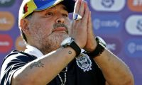 (FILES) In this file photo taken on November 02, 2019, Gimnasia y Esgrima team coach Diego Armando Maradona gestures to supporters as he leaves the field after an Argentina First Division Superliga football match against Estudiantes, at El Bosque stadium, in La Plata, Buenos Aires province, Argentina. - Diego Maradona resigned on November 19, 2019, as coach of Argentina's first-division club Gimnasia y Esgrima La Plata, the president of the club, Gabriel Pellegrino, said. (Photo by ALEJANDRO PAGNI / AFP)
