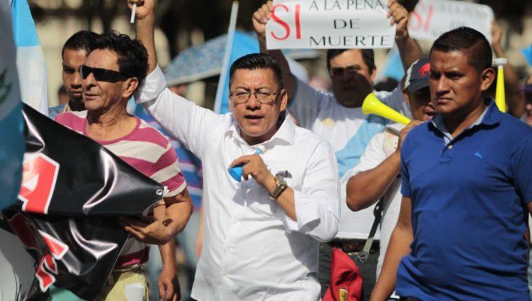 Marcos Yax, el 19 de agosto de 2017, durante una caminata a favor de la reactivación de la pena de muerte. (Foto Prensa Libre: Hemeroteca PL)