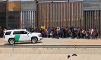 (FILES) In this file photo taken on May 07, 2019 Central American migrants are detained by US Customs and Border Patrol agents at the border wall in Ciudad Juarez, Chihuahua state, Mexico. - The Trump administration moved July 15, 2019 to declare ineligible for asylum most migrants who cross the US southern border after passing through Mexico. A new rule redefining asylum eligibility -- to take effect on July 16, 2019 -- is the latest attempt to stem the flow of undocumented migrants into the country, and comes with the White House frustrated at Congress's failure to toughen immigration laws. (Photo by HERIKA MARTINEZ / AFP)