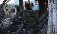 "Members of the Lebaron family watch the burned car where part of the nine murdered members of the family were killed and burned during an gunmen ambush on Bavispe, Sonora mountains, Mexico, on November 5, 2019. - US President Donald Trump offered Tuesday to help Mexico ""wage war"" on its cartels after three women and six children from an American Mormon community were murdered in an area notorious for drug traffickers. (Photo by Herika MARTINEZ / AFP) / ""The erroneous mention[s] appearing in the metadata of this photo by Herika MARTINEZ has been modified in AFP systems in the following manner: [AFP PHOTO / Herika MARTINEZ ] instead of [AFP PHOTO / STR ]. Please immediately remove the erroneous mention[s] from all your online services and delete it (them) from your servers. If you have been authorized by AFP to distribute it (them) to third parties, please ensure that the same actions are carried out by them. Failure to promptly comply with these instructions will entail liability on your part for any continued or post notification usage. Therefore we thank you very much for all your attention and prompt action. We are sorry for the inconvenience this notification may cause and remain at your disposal for any further information you may require."""