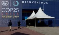Visitors arrive at the UN Climate Change Conference COP25 at the 'IFEMA - Feria de Madrid' exhibition centre, in Madrid, on December 3, 2019. - Spain's Socialist government offered to host this year's UN climate conference, known as COP25, from December 2 to December 13, 2019, after the event's original host Chile withdrew last month due to deadly riots over economic inequality. (Photo by CRISTINA QUICLER / AFP)