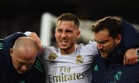 (FILES) In this file photo taken on November 26, 2019 Real Madrid's Belgian forward Eden Hazard gestures in pain during the UEFA Champions League group A football match Real Madrid against Paris Saint-Germain FC at the Santiago Bernabeu stadium in Madrid. - Eden Hazard is set to miss the Clasico against Barcelona after further tests revealed a fracture in his right ankle, Real Madrid confirmed on December 5, 2019. (Photo by GABRIEL BOUYS / AFP)