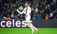Paris Saint-Germain's Brazilian forward Neymar controls the ball during the UEFA Champions League Group A football match between Paris Saint-Germain (PSG) and Galatasaray at the Parc des Princes stadium in Paris on December 11, 2019. (Photo by Bertrand GUAY / AFP)