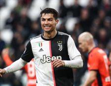 Cristiano Ronaldo celebra uno de los goles de lar Juventus  contra Udinese. (Foto Prensa Libre: AFP).