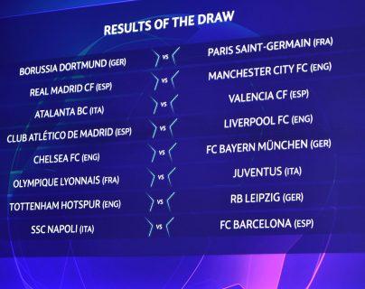 Parte de los resultados que se muestran en la pantalla en la Copa de la Champions. (Foto Prensa Libre: AFP)