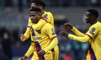 Barcelona´s Guinea-Bissau forward Ansu Fati (L) celebrates after scoring  during the UEFA Champions League Group F football match Inter Milan vs Barcelona on December 10, 2019 at the San Siro stadium in Milan. (Photo by Isabella BONOTTO / AFP)
