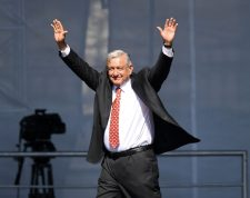Mexican President Andres Manuel Lopez Obrador waves during a rally marking his first year in office at the Zocalo square in Mexico City on December 1, 2019. (Photo by PEDRO PARDO / AFP)