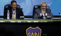 The president of Argentine club Boca Juniors, Jorge Amor Ameal (R), applauds during the presentation of Argentine Miguel Angel Russo (L) as the new coach of Boca, at La Bombonera stadium in Buenos Aires on December 30, 2019. (Photo by Alejandro PAGNI / AFP)
