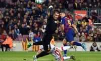Barcelona's Uruguayan forward Luis Suarez (R) scores a goal during the Spanish League football match between FC Barcelona and RCD Mallorca at the Camp Nou stadium in Barcelona on December 7, 2019. (Photo by Josep LAGO / AFP)