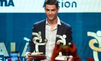 Juventus' Portuguese forward Cristiano Ronaldo receives the award of best player of the year of the Italian championship Serie A arrives to attend the 'Gran Gala del Calcio' awards ceremony, organised by the Italian Footballers' Association (AIC), on December 2, 2019, in Milan. (Photo by MIGUEL MEDINA / AFP)