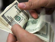 El Banguat tendrá un monto máximo diario de US$50 millones para participar en el Mercado Institucional de Divisas (MID) en cinco subastas de US$10 millones, según la modificación a la política cambiaria que regirá 2020. (Foto Prensa Libre: Hemeroteca)