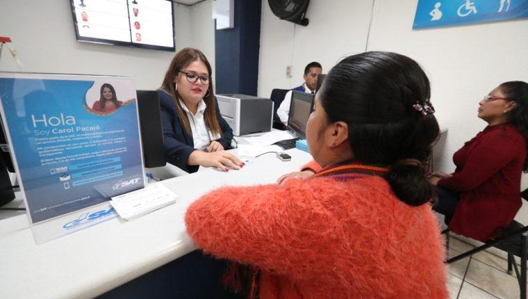 soborno.   Cuatro agencias de la Superintendencia de Administración Tributaria obtuvieron el Certificado ISO 37001 en la prevención de sobornos. (Foto Prensa Libre: Mynor Toc)